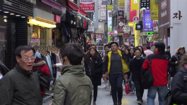 crowded of people walking in the streets of seoul, south korea - corea del sud video stock e b–roll