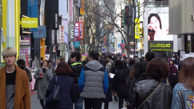 Crowded of people walking in the streets of Seoul, South Korea Crowded of people walking in the streets of Seoul, South Korea south korea stock videos & royalty-free footage