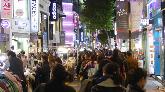 Crowded people in Myeong-dong market in korea city video