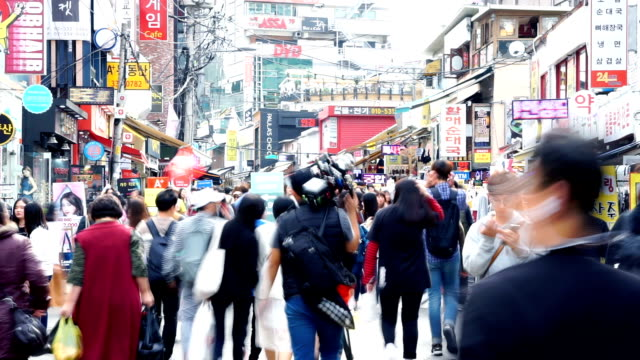 crowded people on business street in tokyo.timelapse video