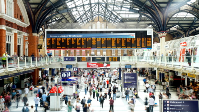 Crowded people train station, Liverpool Street, in London, time lapse Movement of passenger at the train station, Liverpool street, London, time lapse technique in rush hour subway station stock videos & royalty-free footage
