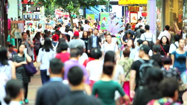 HD: Crowded people walking down the street in Hong Kong video