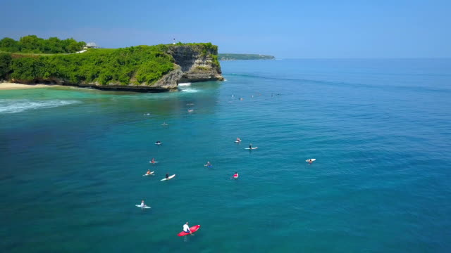 AERIAL: Crowded surfing spot on Balangan Beach near tourist resort in sunny Bali video