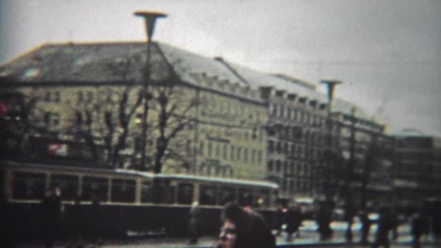 1966: Crowded urban european scene of people walking past mass transit trains. video