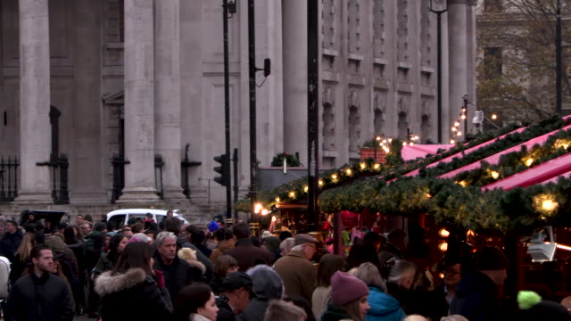 Crowds move in a London Christmas market
