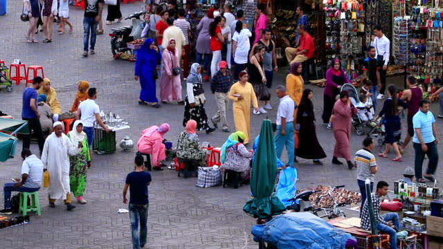 Crowds of pedestrians walking in old town Medina in Marrakesh, Morocco. video