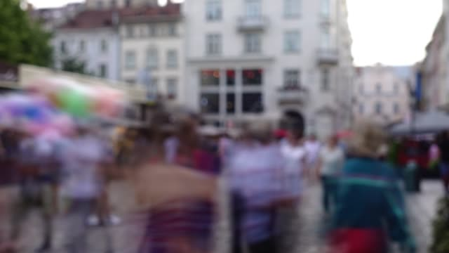 Crowds of people on the streets of the city. Time lapse. Out of focus.