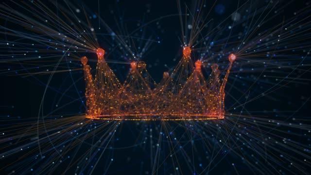 vídeos de stock e filmes b-roll de crown creation from particles - coroa
