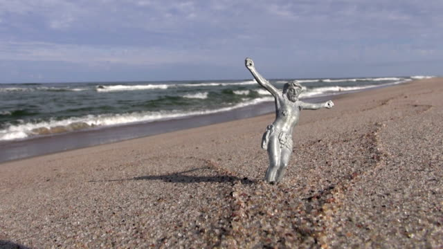 Crucified Jesus Christ without a cross by the sea video