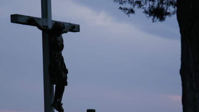 Crucifix Cross At Sundown Cemetery Shot on Red Helium religious cross stock videos & royalty-free footage