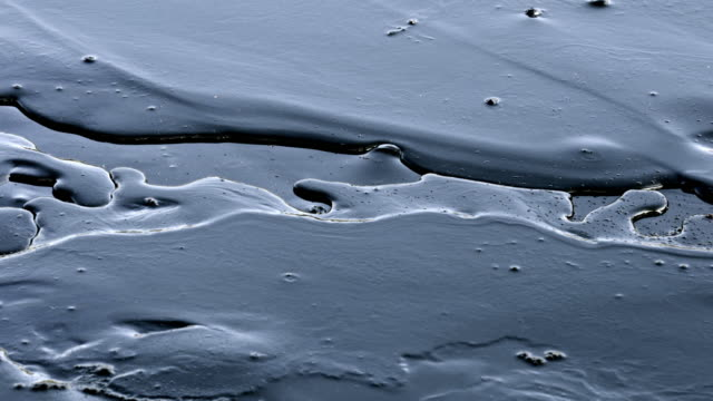 crude oil surface background textured video