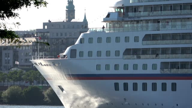 cruise liner in hamburg on departure, elbe and cityscape, - cruise video stock e b–roll