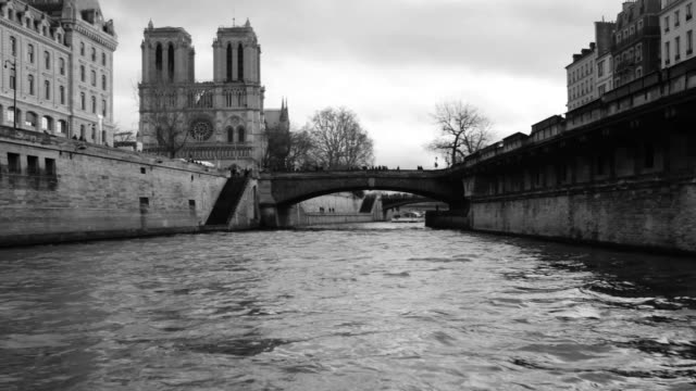 Cruise on the River Seine in Paris, France Cruise on the River Seine view of the Notre Dame Cathedral in Paris, France black and white architecture stock videos & royalty-free footage