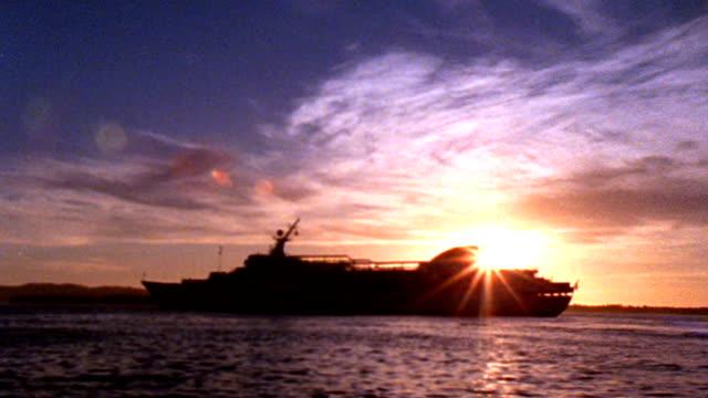cruise ship at sunset - hd - passenger craft stock videos & royalty-free footage