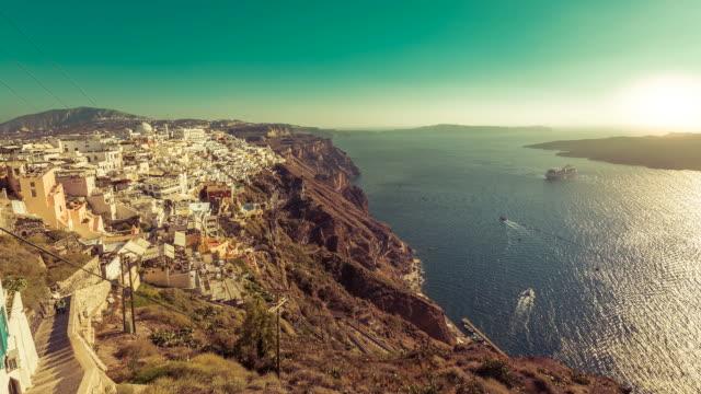 Cruise ship on the Aegan Sea next to Fira city on Santorini Island, Greece