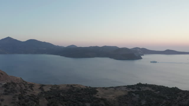 cruise ship passing by islands in greece at sunset - isole egee video stock e b–roll