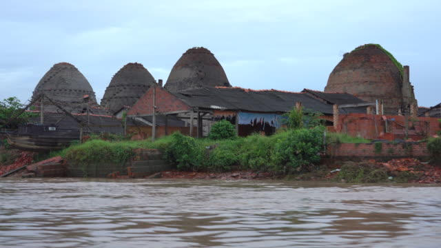 A cruise through the Mekong River Delta in southern Vietnam is full landscape of giant brick beehives oven factory