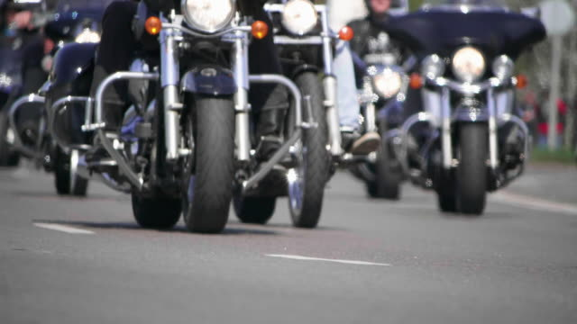 HD - Cruiser motorcycles. Bottom view of a Bikers riding