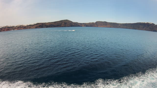 cruising along caldera with view of fira - santorini, greece - passenger craft stock videos & royalty-free footage