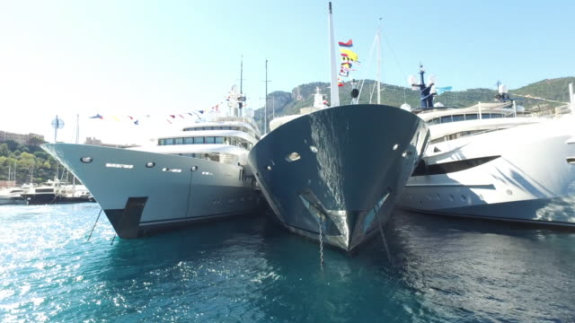 Cruising closely past large yacht bows Cruising past large super yacht bows moored in Port Hercules Monte Carlo for Monaco Yacht Show. monte carlo stock videos & royalty-free footage