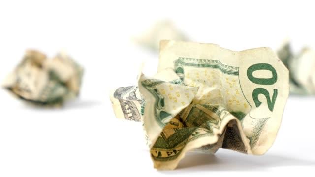 Crumpled dollars on white background