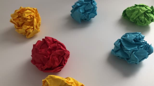 Crumpled paper balls on a table