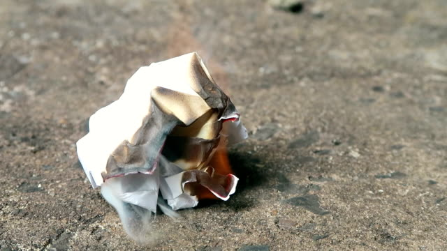 crumpled paper slowly burning video