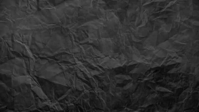 vidéos et rushes de animation en stop motion en papier froissé, fond en papier texturé. le concept de bloc-croquis, design, style rétro, ride, effilochée, vierge - en papier