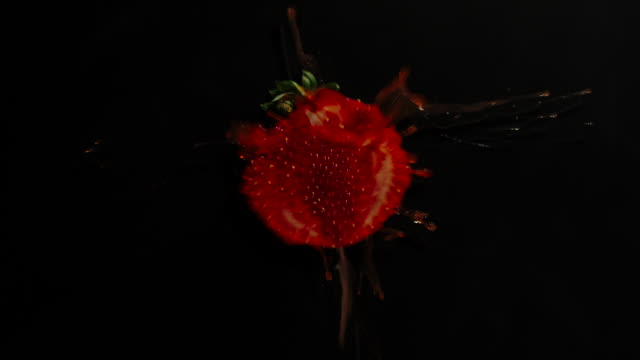Crush The Whole Strawberry Berry On A Black Background