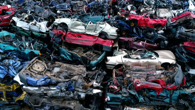 Crushed corroded old cars stacked in scrapyard. video