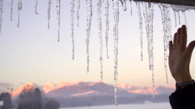 slow motion: crushing icicles - icicle bildbanksvideor och videomaterial från bakom kulisserna