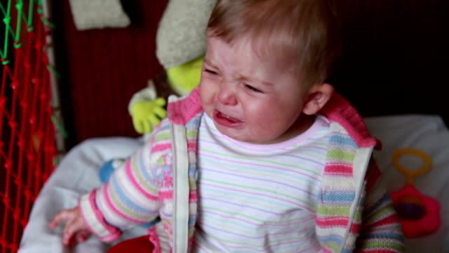 Crying baby sitting in the crib video