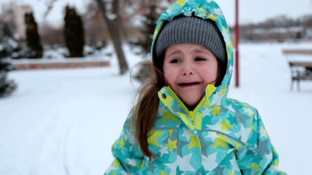 crying toddler outside on winter seasone - abiti pesanti video stock e b–roll
