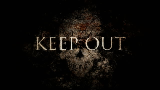 Cryptic Animated Vintage KEEP OUT Sign Over Skull Background Loop video