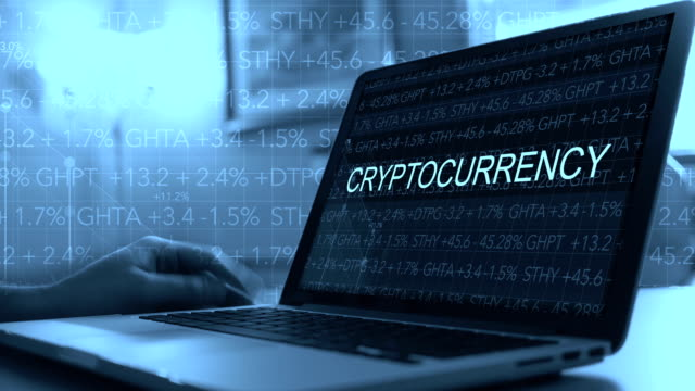 Cryptocurrency concept with stock market ticker scrolling over laptop - Cryptocurrency