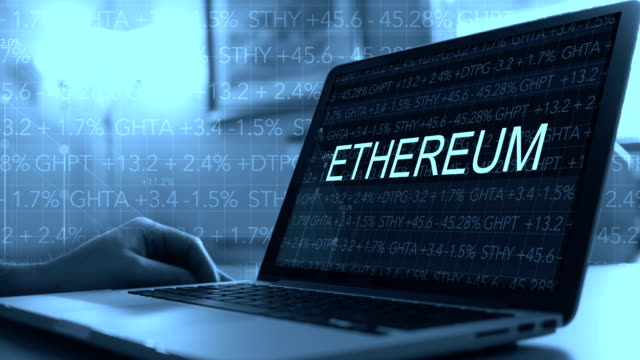 Cryptocurrency concept with stock market ticker scrolling over laptop - Etherium