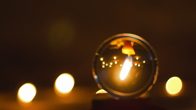 Crystal ball and candle light of wizards, concept of the magical mystery of Halloween