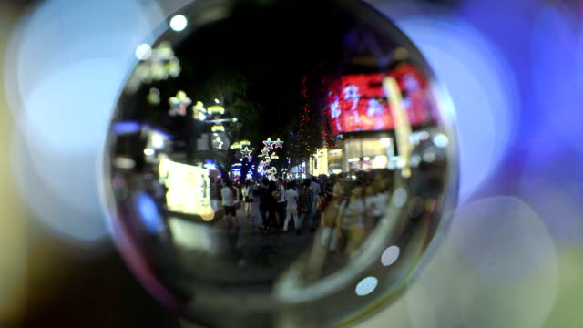 Crystal ball with reflection of Orchard Road Singapore video