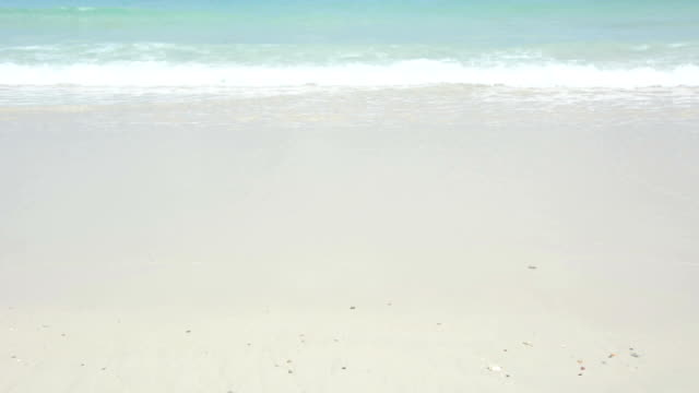 Crystal clear sea water on white sand beach (with sound) video