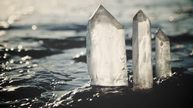 kristallklart. andlig strand solnedgång - mineral bildbanksvideor och videomaterial från bakom kulisserna