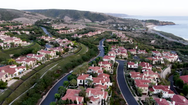 crystal cove neighborhood community in the newport coast before sunset - ocean front properties stock videos & royalty-free footage