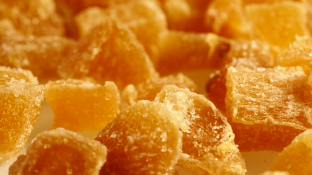 Crystallized candied ginger pieces close up Close up heap of crystallized candied ginger pieces rotating.  Yummy snack, better alternative to candy ginger spice stock videos & royalty-free footage