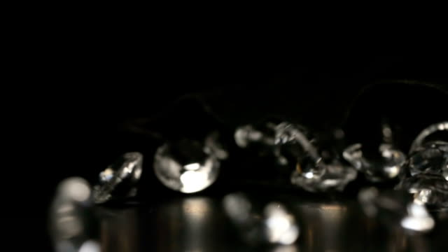 SLOW MOTION: Crystals fall out from a black sac video