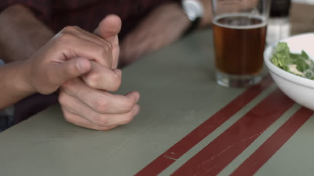 CU_Man & woman holding hands at casual restaurant video