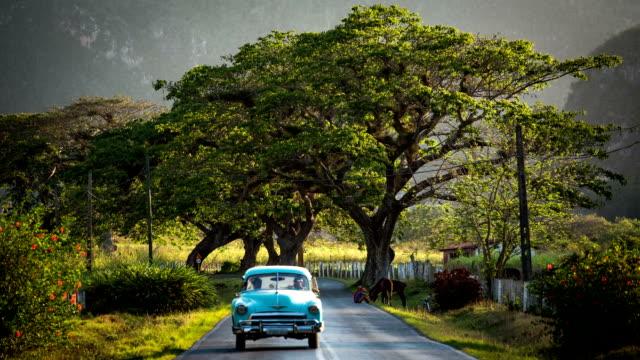 Cuba / Classic Car on scenic Road