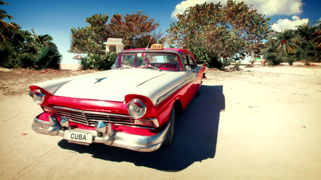 Cuba - Vintage car on beach video