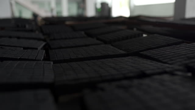 Cube shape briquettes in factory of coconut charcoal for hookah