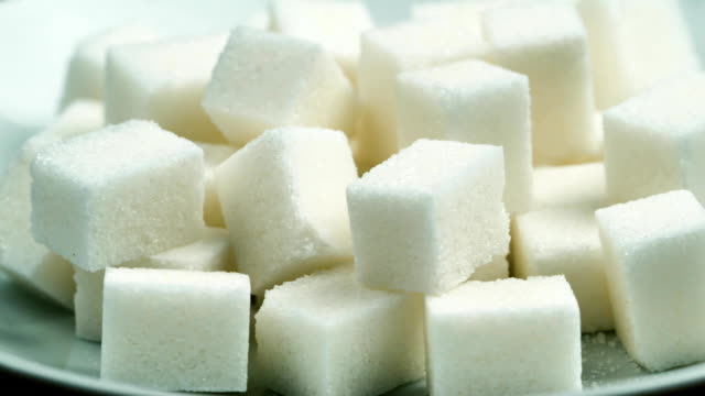 Cubes of sugar refined. Close-up shot video