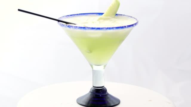 Cucumber Margarita Cucumber Margarita shot on white in studio margarita stock videos & royalty-free footage