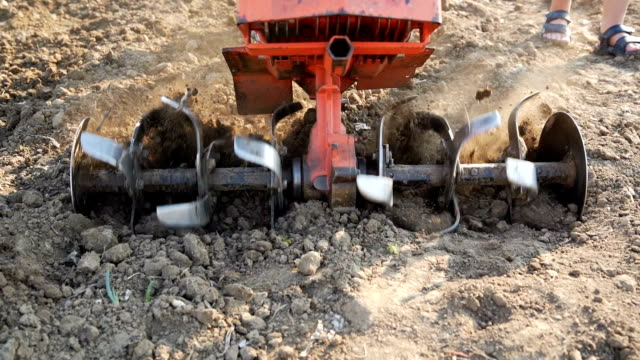 cultivator plowing field cultivator plowing field harrow agricultural equipment stock videos & royalty-free footage